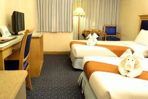 Bossotel-Inn-Chiang-Mai-Thailand-Room.jpg